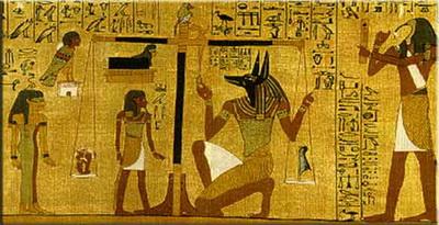 Anubis - Le grand juge de la Loi et la balance avec laquelle il mesure les bonnes et mauvaises actions de l'âme